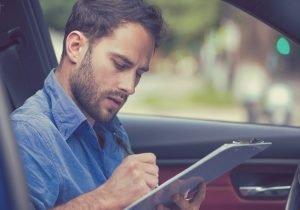 Man in car doing a Diamond Examiner Course